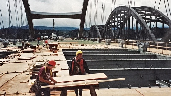Workers preparing a bridge deck for concrete pouring